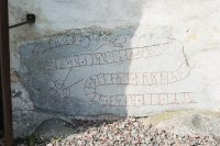 Runic inscriptions on church wall